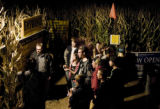 A group of kids listen to a list of rules before entering the corn maze at the Botanic Gardens at...