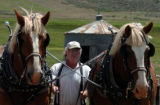 (WOLCOTT COLO.,  July 13, 2004 )  Tom Backhus, of 4-Eagle Ranch, takes his  draft horses to the...
