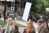 Extras walk by going to lunch as a small scene is being filmed in the background. Nowhereland is a...