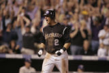 [ES0746] Troy Tulowitzki celebrates after scoring in the first inning. The Colorado Rockies San...