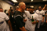 [ES1602] Matt Holliday celebrates in the Rockies clubhouse after their 9-8 victory in 13 innings....