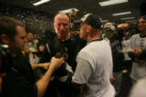 [ES1616] Matt Holliday celebrates with Clint Barmes in the \Rockies clubhouse after their 9-8...