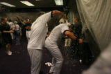 [ES1643] The Rockies celebrate in their clubhouse after their 9-8 victory in 13 innings. The...