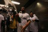 [ES1668] Todd Helton celebrates in the Rockies clubhouse after their 9-8 victory in 13 innings....