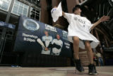 DM1290 Andy Jensen, 7, of Greenwood Village dances in front of Coors Field as fans rally for the...
