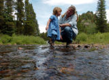 (RED CLIFF Colo., June 26, 2004) Caroline Bradford plays with her two year old daughter Nellie in...