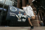 DM1291 Andy Jensen, 7, of Greenwood Village dances in front of Coors Field as fans rally for the...