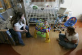 Janay Skinner (cq) and mother Shirlee Skinner (cq), from Alamosa, watch Janay's 10-month-old son...