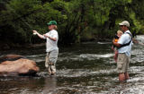 (Basalt Colo., July4, 2004)   Carolin Fassora takes her turn to do some fly fishing on the...