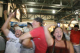 (at right) Stefani Wurzman (cq) celebrates the Rockies win against San Diego along with hundreds...