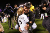 Matt Holliday kisses his son Jackson Holliday after winning the National League Championship...