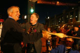 DM1333     Denver Mayor John Hickenlooper and Colorado Governor Bill Ritter touch a broom for luck...