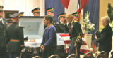 Last farewells are said during the funeral for Brigadier General Felix Sparks (cq) Tuesday October...