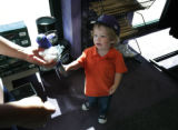 Getting the essentials cap/bat and ball, 23 month old Jackson Doland of Arvada gets what he want...