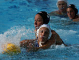 American water polo player Heather Moody, right, chase the ball against Australia's Naomi Castle...