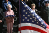 Mary Frances Sparks, wife, (from p.r.) holds the folded flag as she watches her husband's coffin...