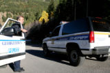 Officer Nick Borys of the Georgetown Police Department Rescue mans a road block on Guanella Pass...