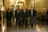 Frank Bingham (cq) walks (at center) along the hall of the Denver District court at the beginning...