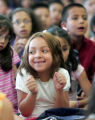 Alize Archibeque, (front) a 2nd grader at Remington Elementary  School, listens to her principal,...