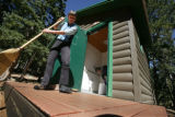 Teresa and Neal Taylor work together to clean the outdoor toilets  at Barr Camp, in Manitou...