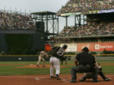 Colorado Rockies batter Garrett Atkins hits the ball against Padre pitche Jake Peavy starting...