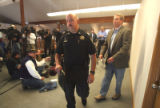 Clear Creek County Undersheriff  Stu Nay (cq) and XCEL Spokesperson Tom Henley (cq)  exit a  press...