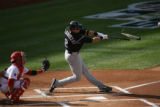 #2 Troy Tulowitzki  of theColorado Rockies suffers a broken bat against the Philadelphia Phillies...
