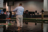 A casting judge cools his feet in a casting pool at the Fly Fishing Retailer show. The trade show...