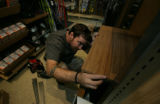 Mike McCawley (cq)  installs shelving made of plyboo at REI in Boulder, Colo. Wednesday, October...