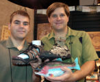 Zach Hyatt, left, holds Bite's cozy fishing sandal, while sales manager Jason Zambron introduces...
