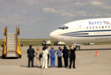 (DENVER, Colo., August 26, 2004) A small group of people escorted onto the runway as the plane...