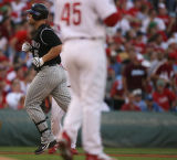 [ES1815] Colorado Rockies left fielder Matt Holliday rounds the bases in the top of the eights...