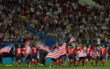 (ATHENS, GREECE- AUGUST 26,2004) United States' women's soccer team race around the field with...