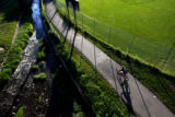 DM1827     A man rides his bike on the bike path that runs along Lakewood Gulch in Rude Park in...