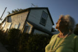 DM1841     Longtime Lakewood Gulch resident Nettie Moore stands in front of the house that has...