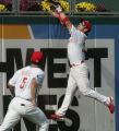 [JOE0686] Philadelphia Phillies Aaron Rowand leaps to the wall as  Colorado Rockies batter Troy...