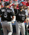 [JOE0722] Colorado Rockies batter Todd Helton (17)  waits to high five teammate Matt Holliday (5)...