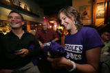 Waitress, Michelle Miller, (cq)  hands out free t-shirts that comboed the tavern and rockies...