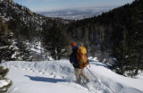 Jeremy Jones of Stafford, Va., hikes above No Name Creek along Barr Trail with Colorado Springs...