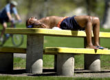 (DENVER, Colo., April 27, 2004) Troy Roebuck, from Aurora, relaxes in the sun after an afternoon...