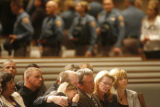 (from left to right) The girlfriend of Colorado State Trooper Zachariah Templeton (cq) rests her...