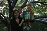 Tara (mom) and Kelly (dad) and Kasey (son) and Gavin (son, 3 months in family photo) together in...
