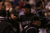 [ES0540] Rockies relief pitcher Matt Herges is congratulated by teammates after he got the team...