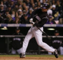 [JOE0149] Colorado Rockies Brad Hawpe hits a single in the eighth inning to move baserunner...