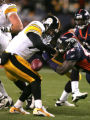 Ben Roethlisberger is stripped of hte ball in the 2nd quarter by #92 Elvis Dumervil in the 2nd...