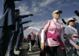 Kari Vier (cq), 39, center, walks under the swords of the Airforce Academy's Sabre Drill Team, as...