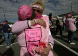 Burdell Maez (cq), back to the camera, a seven year breast cancer survivor from Wheatridge, hugs...