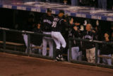 Ubaldo Jimenez is congratulated by his teammates upon returning to the dugout after retiring the...