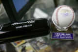 A Todd Helton bat and a World Series baseball signed by Helton, are for sale, Monday afternoon,...