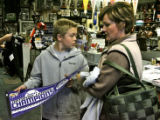 Ann Adams, (cq), right, and her son Jack Adams, look at Rockies memorabilia, Monday afternoon,...